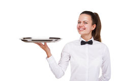 Young woman in waiter uniform holding tray isolated over white b Stock Photography