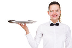 Young woman in waiter uniform holding tray isolated over white b Royalty Free Stock Photo