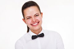 Young woman in waiter uniform isolated over white background. Stock Image