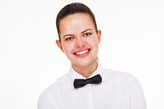 Young woman in waiter uniform isolated over white background. Royalty Free Stock Photo