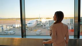 Young woman waiting in airport her flight royalty free stock image
