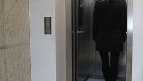 Young woman waiting  the elevator stock video