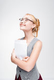 Young woman waiting with excitement for good news. Young woman in glasses waiting with excitement for good news. Nice blonde feels thrilled and excited, great Royalty Free Stock Photography
