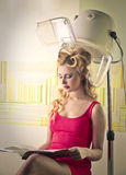 Young woman waiting at the hair dresser Stock Photography