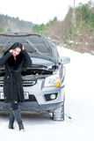 Young woman waiting for help or assistance after her car breakdo Royalty Free Stock Photo