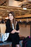Young woman waiting in international airport Royalty Free Stock Photo