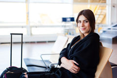 Young woman waiting in international airport Royalty Free Stock Photos