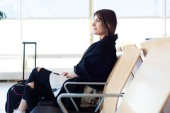 Young woman waiting in international airport Stock Images
