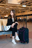 Young woman waiting in international airport Royalty Free Stock Image