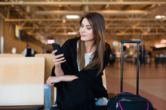 Young woman waiting in international airport Royalty Free Stock Photography