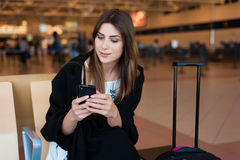 Young woman waiting in international airport Stock Photography