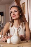 Young woman waiting in restaurant Stock Photo