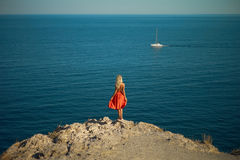 Young woman waiting for sailboat Stock Images