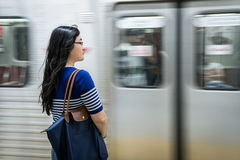 Young woman waiting at subway station Stock Photo