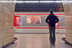 Young woman waiting for the subway train Royalty Free Stock Photography