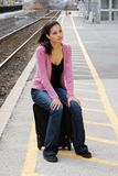 Young woman waiting for the train Royalty Free Stock Photography
