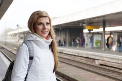 Young woman waiting for the train Stock Photos