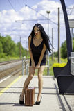 Young woman is waiting for a train Stock Image