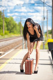 Young woman is waiting for a train Stock Photography