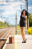 Young woman is waiting for a train Stock Photos