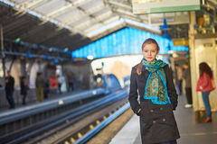 Young woman waiting for a train on the platform of Parisian unde Royalty Free Stock Photo