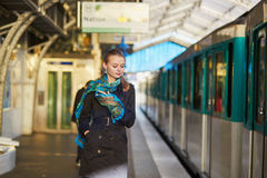 Young woman waiting for a train on the platform of Parisian underground Stock Photo
