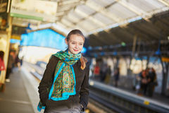 Young woman waiting for a train on the platform of Parisian underground Royalty Free Stock Photos