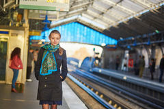 Young woman waiting for a train on the platform of Parisian underground Stock Photography