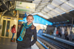 Young woman waiting for a train on the platform of Parisian underground Royalty Free Stock Image