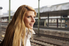 Young woman waiting for the train Royalty Free Stock Photos