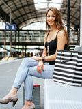 Young woman waiting at the train station Stock Photography