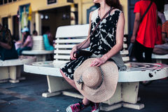 Young woman waiting at train station Stock Images