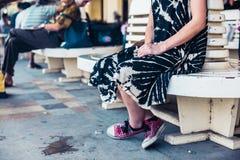 Young woman waiting at train station Royalty Free Stock Photo