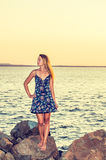 Young Woman Waiting for You on Sunset Stock Photo