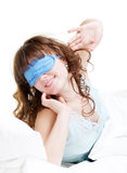 Young woman wake up and stretching oneself Royalty Free Stock Images