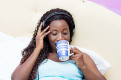 Young woman wakes up in music Royalty Free Stock Image