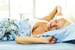 Young woman waking up Stock Photography