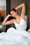 Young woman waking up happy and rested. Young beautiful, woman waking up happy and rested Stock Photos