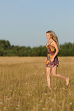 Young woman walk in the field Stock Images
