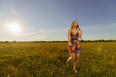 Young woman walk in the field Stock Photo