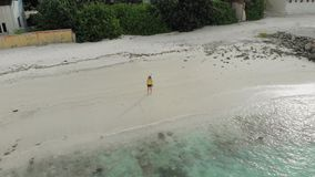Young woman walk near the ocean. Tropical island on a coral reef, a Paradise of nature. stock video
