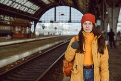 Woman walk by railway station stock photos
