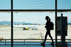 Young woman walking at airport Stock Photos