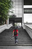Young woman walking alone climb the stairs in a modern neighborh Royalty Free Stock Images
