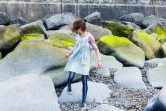 Young woman walking amongst vibrant rocks Stock Image