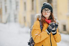Young woman is walking around the city for Christmas. Snow. Concept Lifestyle, Urban, Winter, Vacation, Happy Christmas. Beautiful girl walking around the winter stock images