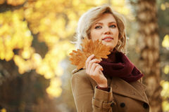 Young woman walking in autumn forest Royalty Free Stock Images