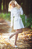 Young woman walking in autumn park Stock Photography