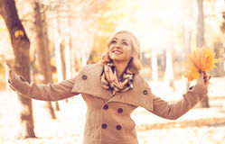 Young woman walking in an autumn park Stock Image