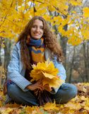Young woman is walking in the autumn wood Royalty Free Stock Image